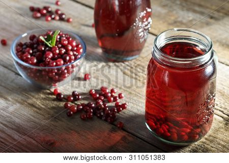 Homemade Vitamin Drink. Cranberry Juice And Fresh Cranberries On The Table