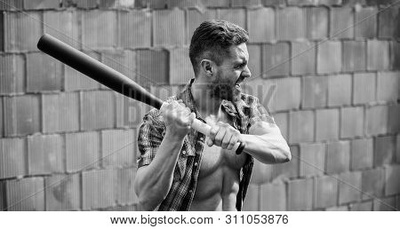 Man Unshaven Face Muscular Torso Hold Black Baseball Bat. Strong Temper. Confident His Strength. Bul