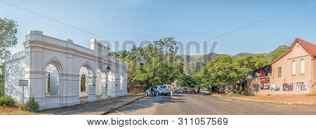 Barberton, South Africa - May 2, 2019: A Street Scene, With The Entrance To The Historic De Kaap Sto