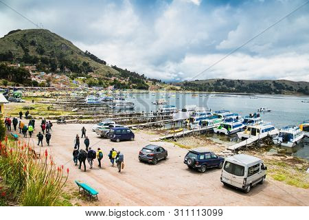 Copacabana, Bolivia-Jan 4, 2019: Many tour boats in the harbor of the small tourist town of Copacabana in a bay of Lake Titicaca in Copacabana,  Bolivia.
