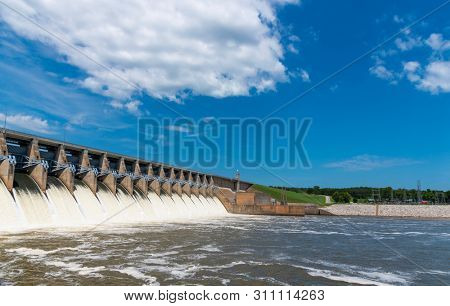 Water rushing out of open gates of a hydro electric power station