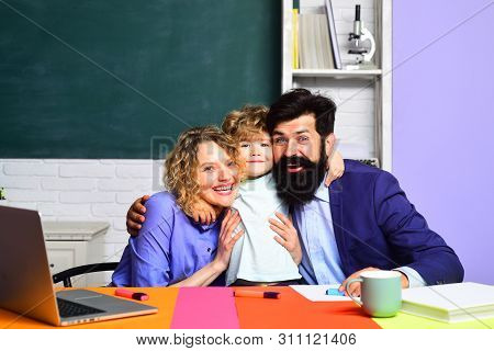 Happy Family Schooling Together. Family School. Little Boy And His Parents. Family Educational Right