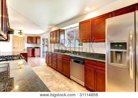Large Bright Kitchen With Dark Cherry Cabinets.