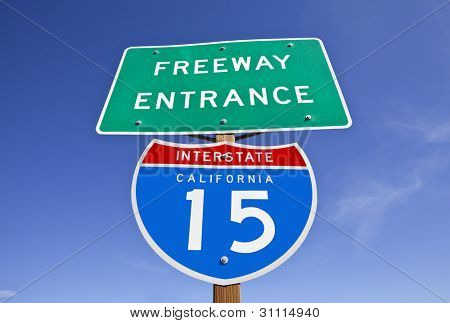 Interstate 15 freeway entrance sign in California's Mojave desert.