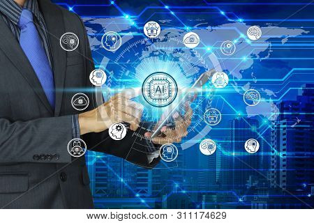 Businessman Use Tablet With Virtual Screen Artificial Intelligence Technology Icon Over The Network