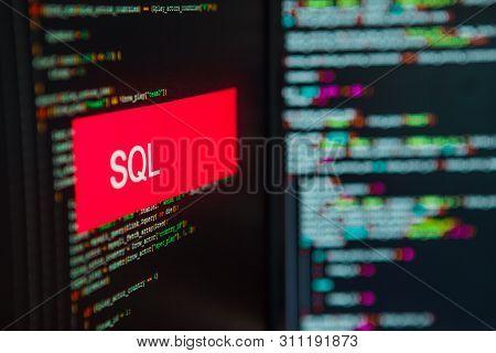 Programming Language, Sql Inscription On The Background Of Computer Code. Modern Digital Technologie
