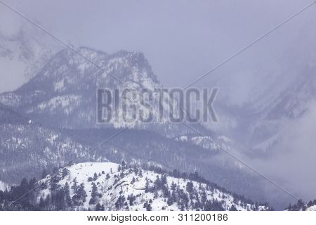 Snow Storm Rolling Over Mountain Peaks In Rocky Mountain National Park