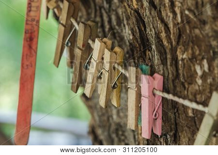 Clothespin hanging with a rope Used to decorate a place in a coffee shop