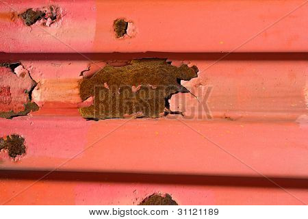 rusted container wall in red