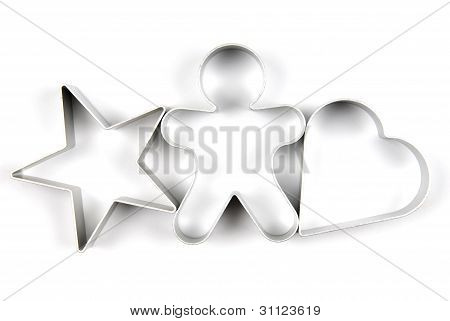 Star gingerbread and heart pastry cutters on white background
