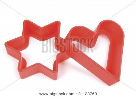 Star and heart pastry shapes on white background. Clipping path included.