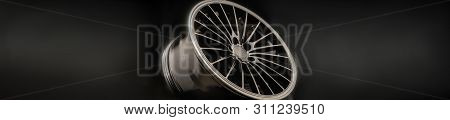 new Luxury Black alloy Wheel, sporty with thin spokes, copy cpace on black background. poster