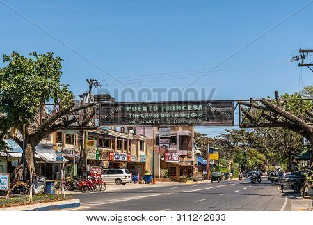 Puerto Princesa, Palawan, Philippines - March 3, 2019: Street View Of Rizal Avenue With Wooden Banne