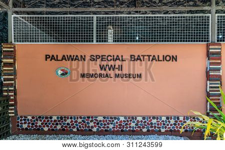 Puerto Princesa, Palawan, Philippines - March 3, 2019: Sign Of Black Characters On Red Of Palawan Sp