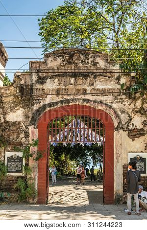 Puerto Princesa, Palawan, Philippines - March 3, 2019: Historic Stone Gate To Plaza Quartel Shows Re