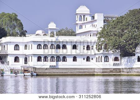 Udaipur, Rajasthan, India - 14 July 2019: Abstract Background Of Distant View Of Taj Lake Palace, Ud