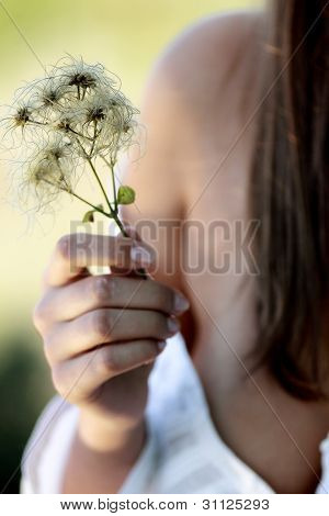 blurred woman with flower