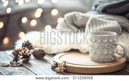 Coffee Cup Over Christmas Lights Bokeh In Home On Wooden Table With Sweater On A Background And Deco
