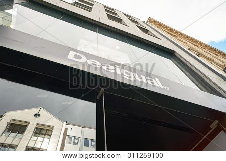 COLOGNE, GERMANY - CIRCA OCTOBER, 2018: Desigual brand name over a shop entrance in Cologne.