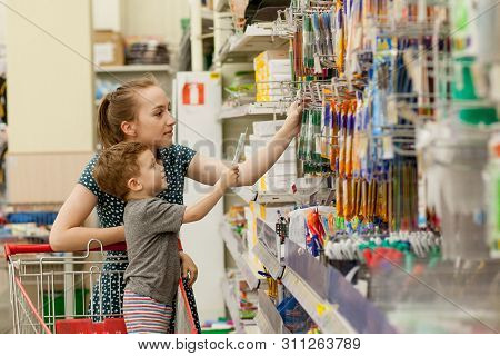 Kyiv, Ukraine- May 15, 2019 Mother Riding Their Child In Shopping Trolley At School Stationery Store