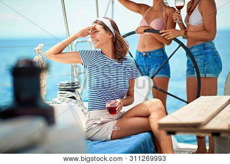 Cheerful girl on a yacht, boat trips. Summer holidays