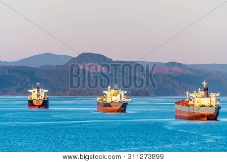 Fleet Of Cargo Ships Sailing The Ocean. Container Nautical Vessels With Shipment Of Export Goods Mak