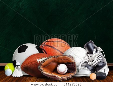 Sports Equipment, Rackets And Balls For All Seasons In Classroom Background With Chalkboard And Copy