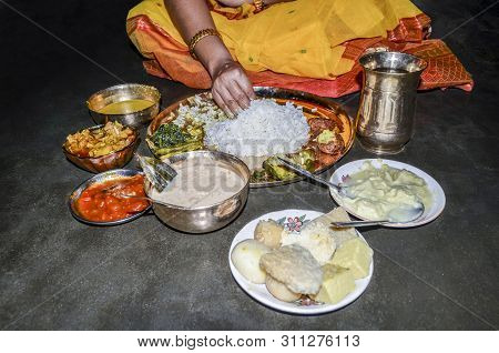 Indian Woman Eating Vegetarian Thali By Her Hand, Indian Veg Thali Or Restaurant Style Complete Food