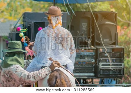 Young Man Riding Horse With Music Band In Ordination Ceremony In Buddhist Thai Monk Ritual For Chang