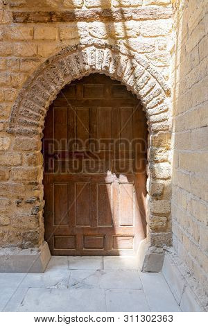 Vaulted Closed Wooden Grunge Door In Bricks Stone Wall, Old Cairo, Egypt
