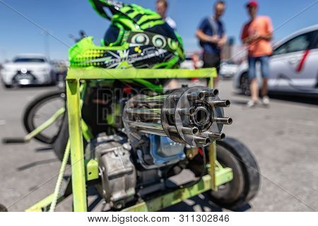 Drift Trike With Big Front Wheel And Motor And Exhaust Pipe In The Shape Of Mini Gun