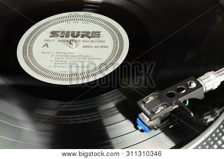 London, England - May 08, 2019: Vintage Vinyl Record With Emi Harvest Label Played On The Technics T