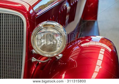 Close Up Of Headlight, Mudguard And Running Board Of Red Custom Classic Vintage Car
