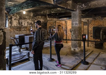Oswiecim, Poland - May 6: Visitors In The Crematorium At Concentration Camp In Auschwitz On May 6, 2