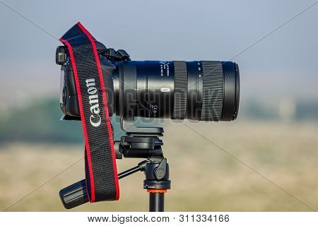 Tele Zoom Lens With Camera Mounted On The Tripod Ready For Shooting At Desert Winter Season. City Da