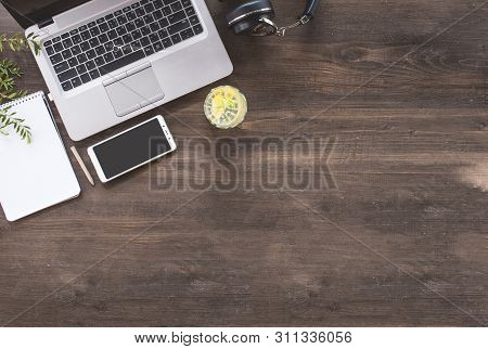 Top View Of Hipster Wooden Workspace, Office Table Desk, Flat Lay Image Of Two Coworkers Using Lapto