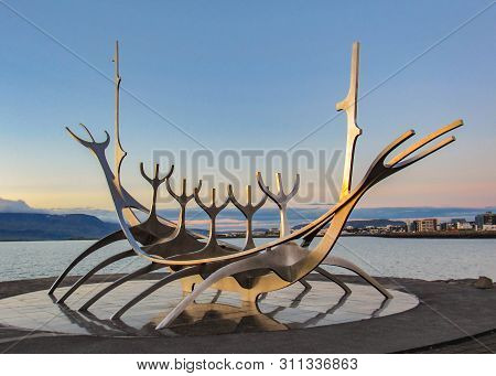 Sun Voyager Iconic Symbol Of Reykjavik At Sunset: Sculpture Of Viking Ship On Harbor, Reykjavik, Ice