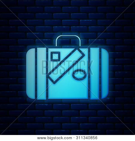 Glowing Neon Suitcase For Travel And Stickers Icon Isolated On Brick Wall Background. Traveling Bagg