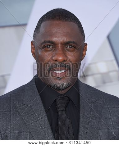 LOS ANGELES - JUL 13:  Idris Elba arrives for the 'Fast & Furious Presents: Hobbs and Shaw' World Premiere on July 13, 2019 in Hollywood, CA