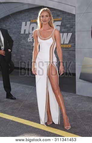 LOS ANGELES - JUL 13:  Rosie Huntington-Whiteley arrives for the 'Fast & Furious Presents: Hobbs and Shaw' World Premiere on July 13, 2019 in Hollywood, CA