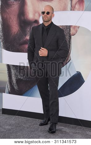 LOS ANGELES - JUL 13:  Jason Statham arrives for the 'Fast & Furious Presents: Hobbs and Shaw' World Premiere on July 13, 2019 in Hollywood, CA