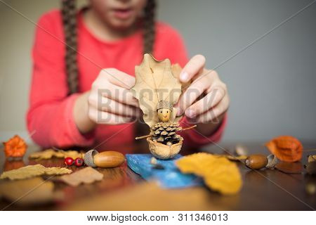 Autumn Craft With Kids. Childrens Cute Boat With Man Made Of Natural Materials. Process Of Creating