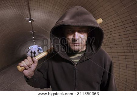 Older Addict Man In Black Hooded Shirt With Weapon