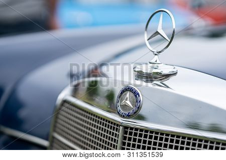 Paaren Im Glien, Germany - June 08, 2019: The Famous Three-beam Star Of Mercedes-benz. Hood Ornament
