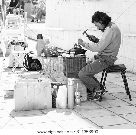 Buenos Aires, Argentina. July 14, 2019. Street Craftsman, Engraver. Engraves The Inscriptions On The