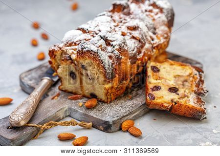 Bread Pudding Of Buns, Banana Slices, Cream Cheese, Eggs And Cream Sprinkled With Powdered Sugar On