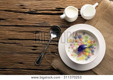 Thai Sweets And Colorful Ball Flour In A White Cup On A Sackcloth, Coconut On An Old Wooden Table Ra