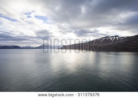 The Photo Shows A Bay On Spitsbergen During Midsummer
