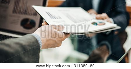 Manager Of Finance Takes Financial Statement From The Employee O