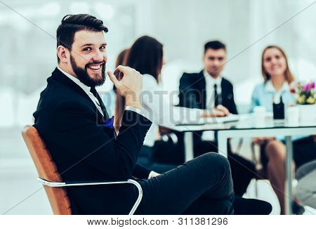 Manager Of The Company On The Background Of The Working Meeting